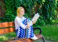 Literary critic. Lady pretty bookworm busy read book outdoors sunny day. Woman concentrated reading book in garden Royalty Free Stock Photo