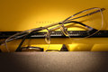 Literature concept inspiration closeup of eyeglasses on electrical typewriter with yellow paper sheet Royalty Free Stock Images