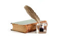 Literature concept stylish vintage inkwell near old book on white background Stock Images