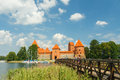 Lithuania trakai july tourists are photographed on a bridge across the lake to the fortress old medieval castle in Royalty Free Stock Photos