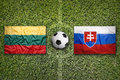 Lithuania vs. Slovakia flags on soccer field