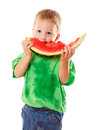 Litle boy eating a watermelon isolated on white Royalty Free Stock Images