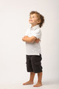 Litle boy standing with his arms crossed Stock Images