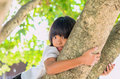 Litle girl smile happy on tree Royalty Free Stock Photo