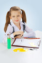 A litle school girl on blue background Stock Images