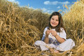 Littel girl in a wheat field Royalty Free Stock Photo