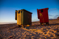 Litter box two boxes standing on a beach Royalty Free Stock Images