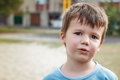 Little active sweating boy after play outdoor Royalty Free Stock Photo