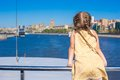 Little adorable girl on the deck of a ship sailing in big city Royalty Free Stock Photos