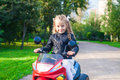 Little adorable girl on her toy motorcycle this image has attached release Stock Photography