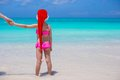 Little adorable girl in red Santa Hat enjoy beach Royalty Free Stock Photo