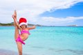 Little adorable girl in red Santa hat at tropical Royalty Free Stock Photo