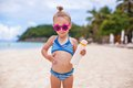 Little adorable girl in swimsuit rubs sunscreen herself this image has attached release Stock Photography