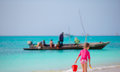 Little adorable girl walking with beach toys during tropical vacation Royalty Free Stock Photo