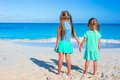 Little adorable girls during tropical beach Royalty Free Stock Photo