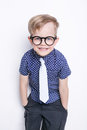 Little adorable kid in tie and glasses. School. Preschool. Fashion. Studio portrait isolated over white background Royalty Free Stock Photo
