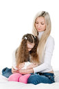 Little affliction young mother preachs her daughter on white Royalty Free Stock Photography