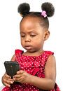 Little african american girl with mobile phone against white background Royalty Free Stock Images