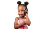Little african american girl talking to the phone and smiling Royalty Free Stock Photography