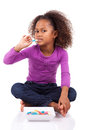 Little African Asian girl eating  candy Stock Photography