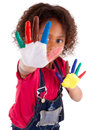 Little african asian girl with hands painted in colorful paints Royalty Free Stock Images