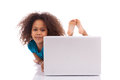 Little african asian girl using a laptop Royalty Free Stock Images