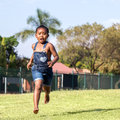 Little african girl running in park. Royalty Free Stock Photo