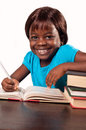Little african school girl cute studying over white background Royalty Free Stock Photography
