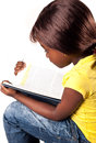 Little african school girl cute studying over white background Stock Photography