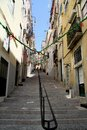 Little alley in alfama in lisbon portugal old Royalty Free Stock Photos