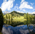 Little alpine lake in austria at the dachstein mountains filzmoos Royalty Free Stock Photography