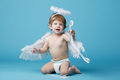 Little angel on blue background Royalty Free Stock Photo