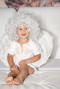 Little angel boy with wings and a white wig Royalty Free Stock Photo
