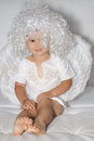 Little angel boy with wings and a white wig Royalty Free Stock Image