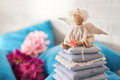 Little angel doll sitting on a pillow. Valentine`s day. Children`s toy hand made