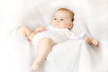 The little angel pretty white dressed baby lies on white chair Stock Photo