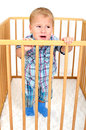Little angry boy small is crying in playpen Stock Images