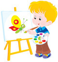 Little artist draws boy drawing a picture with a funny cartoony butterfly Stock Photography