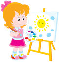 Little artist girl drawing a picture with a smiling yellow sun and small blue clouds Stock Photo