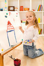Little artist girl painting her dream house Royalty Free Stock Photo