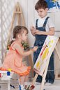 Little artists boy and girl painted in his studio Royalty Free Stock Photos