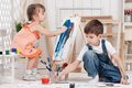 Little artists boy and girl painted in his studio Stock Photos