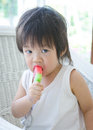 Little asian baby with icecream boy Stock Photos