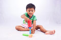 Little asian boy play toy tool plastic on white background Stock Photography