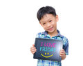 Little asian boy smiles with tablet computer on white background and message i love fridayon screen Stock Photos