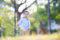 Little asian boy standing in the park outdoor and nature background Stock Images