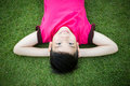 Little Asian child laying down on the grass Royalty Free Stock Photo