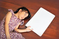Little Asian child laying down on the wooden background with a b Royalty Free Stock Photo