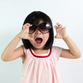 Little asian child portrait of girl wearing sunglasses Royalty Free Stock Image