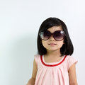 Little asian child portrait of girl wearing sunglasses Stock Photography